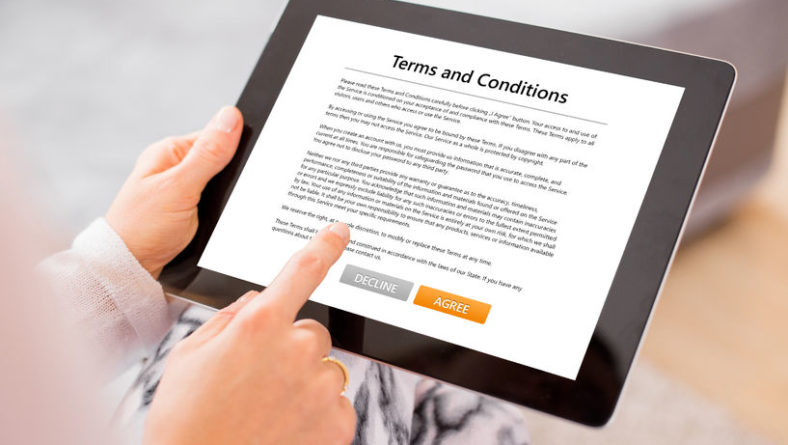 67739320 – person accepting terms and conditions on tablet